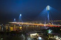 China, Hong Kong, view of bridge over water at night — Stock Photo