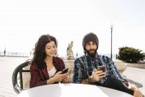 Couple using cell phones — Stock Photo