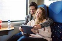 Couple using digital tablet — Stock Photo