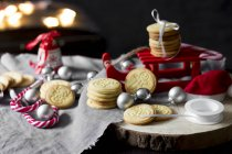 Christmas decoration with miniature sledge and shortbread — Stock Photo