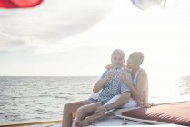 Happy couple having a drink on a boat trip — Stock Photo