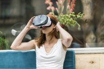 Redheaded woman wearing Virtual Reality Glasses — Stock Photo