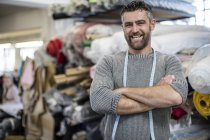 Portrait of confident tailor in workshop with arms crossed — Stock Photo