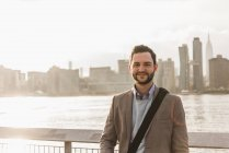 Portrait of confident businessman at East River, New York City, USA — Stock Photo