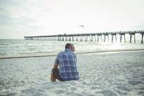 USA, Man sitting at Panama City Beach — Stock Photo
