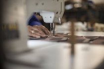 Seamstress working with sewing machine, closeup — Stock Photo