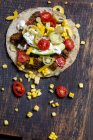 Mexican Tortilla with mincemeat, avocado, tomato, corn, Jalapeno pepper and sour cream — Stock Photo