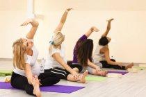 Women making exercises at prenatal yoga class — Stock Photo