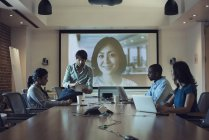 Business people having a video conference in board room — Stock Photo
