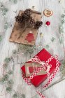 Christmas decoration and wrapped presents on wood — Stock Photo