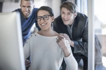 Young creative professionals working together in office — Stock Photo
