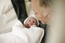 Father with newborn baby looking at him — Stock Photo