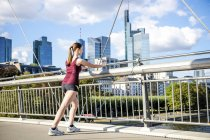 Young athlete stretching on bridge — Stock Photo