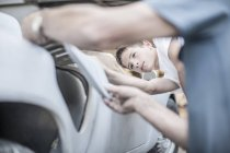 Close-up of Boy with grandfather scrutinizing car — Stock Photo