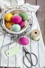 Colourful Easter basket with twine and tag — Stock Photo