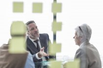 Three confident business people discussing in office — Stock Photo