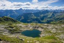 Germany, Bavaria, Allgaeu, Allgaeu Alps, Laufbichel lake, Hochvogel mountain in the background — Stock Photo