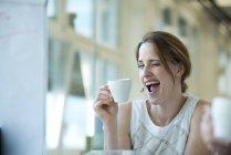 Portrait of playful businesswoman winking — Stock Photo
