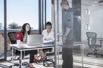 Young professionals working together in office — Stock Photo