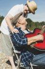 Happy senior couple with guitar — Stock Photo