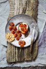 Roasted tomatoes, crostini with goat cheese and garlic on plate — Stock Photo