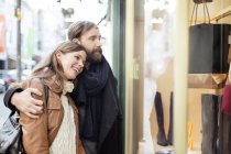 Couple looking in shop window — Stock Photo