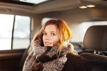 Woman sitting in car — Stock Photo