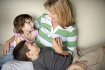 Little boy and girl with their grandmother on the couch — Stock Photo