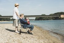 Senior couple relaxing at riverside — Stock Photo
