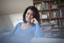 Portrait of smiling relaxed woman at home — Stock Photo
