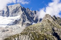 Switzerland, Canton of Uri, Goescheneralp, Moosstock with Dammastock glacier during daytime — Stock Photo