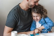 Father and daughter having fun at breakfast table — Stock Photo