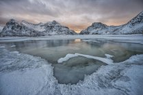 Norway, Lofoten, Frozen pond in the mountains — Stock Photo