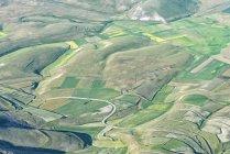Italy, Umbria, Monti Sibillini National Park, Aerial view of the fields on Piano Grande of Castelluccio di Norcia — Stock Photo