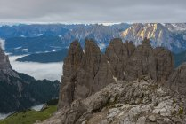 Italy, Alto Adige, Dolomites, view to Cadini di Misurina mountains at sunrise on a cloudy day — Stock Photo