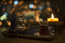 Close up of Turkish tea, candle light — Stock Photo
