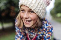 Portrait of smiling girl wearing woolen cap — Stock Photo
