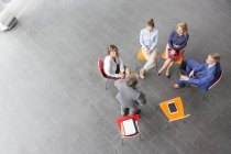 Overhead view of Businessman leading a presentation — Stock Photo