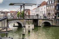 Belgium, Flanders, Bruges, old drawbridge over water — Stock Photo