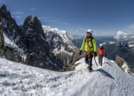 France, Chamonix, Alps, Petit Aiguille Vert, mountaineers in snow covered mountains — Stock Photo