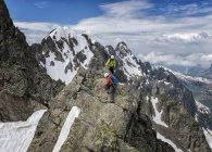 France, Chamonix, Alps, Petit Aiguille Vert, mountaineers climbing on mountain peak — Stock Photo