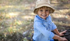 Portrait of smiling blond little boy wearing hat — Stock Photo