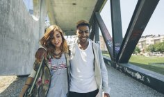 Young couple in love walking outdoors — Stock Photo