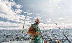 Fisherman holding fishing net on fishing boat on Cantabrian Sea, Asturias, Spain — Stock Photo
