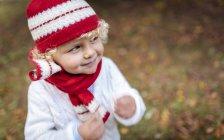 Portrait of blond little boy wearing fashionable knit wear in autumn — Stock Photo