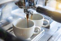 Coffee machine preparing two cups of coffee — Stock Photo