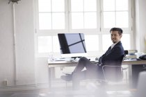 Businessman sitting in office, working on computer — Stock Photo