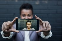 Photography of young woman taking a selfie on display of smartphone — Stock Photo
