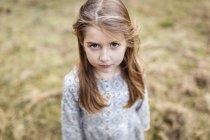 Portrait of sad little girl outdoors — Stock Photo