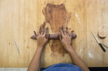 Female hands of woman working with clay in a ceramics workshop — Stock Photo
